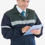 Mature repairman holding digital tablet — Stock Photo
