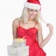 Happy woman holding christmas presents — Stock Photo