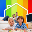 Stock Photo: Two children lying on a carpet in front of house illustration an