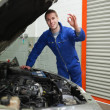 Mechanic by car making ok sign — Stock Photo #24097637