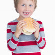 Cute happy young boy holding burger — Stock Photo #24097893