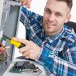 Computer engineer repairing cpu at workplace — Stock Photo