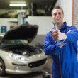 Stock Photo: Male mechanic showing spanner