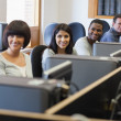 Smiling group in computer class - Stock Photo
