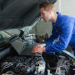 Royalty-Free Stock Photo: Auto mechanic working on laptop