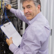 Stock Photo: Datcenter worker checking servers