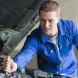 Stock Photo: Mechanic working on automobile engine