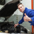 Auto mechanic by car gesturing thumbs up — Stock Photo #24098667