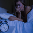 Unquiet blond woman in the bed at night — Stock Photo #24098929