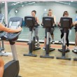 Womteaching spinning class — Stock Photo #24099265
