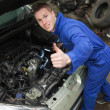 Auto mechanic showing thumbs up sign — Stock Photo #24099285