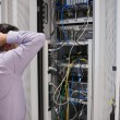 Stock Photo: Technicifeeling frustrated over servers