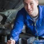 Man working on car engine — Stock Photo #24099397