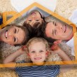 Smiling young family in front of orange house illustration — Stock Photo