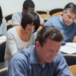 Students working in lecture hall — Stock Photo