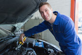 Male mechanic fixing car engine — Stock Photo