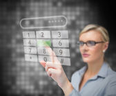 Businesswoman dialing number — Stock Photo