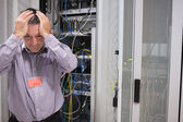 Man looking weary of data servers — Stok fotoğraf