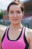 Woman in pink sportswear — Stock Photo