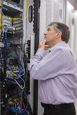 Technician searching for a solution in the server case — Stock Photo