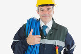 Confident mature man with rolled wire — Stock Photo