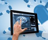Hand touching brain on a digital tablet — Zdjęcie stockowe