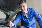 Male mechanic working on automobile engine — Stock Photo