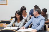 Students talking in lecture hall — Stock Photo