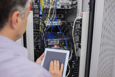Man doing server maintenance with tablet pc — Stock Photo