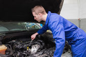 Mechanic working under car bonnet — Stock Photo