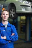 Smart car mechanic smiling — Stock Photo