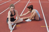 Women stretching on the track — Stock Photo