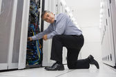 Man fixing server wires — Foto de Stock
