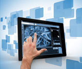 Hand touching a digital tablet on a digitally generated backgrou — Stock Photo