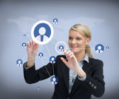 Businesswoman using touch screen with contacts on — Stock Photo