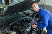 Auto mechanic by car with tablet pc — Stock Photo