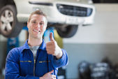 Male mechanic giving thumbs up — Stock Photo