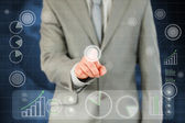 Businessman's finger activating futuristic touchscreen — Stock Photo