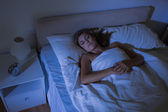 Calm woman sleeping at night — Stock Photo