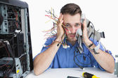 Portrait of tired it professional with cables in hands — Stock Photo