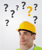 Man in hard hat thinking — Stock Photo