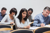 Students taking notes in lecture — Stock Photo