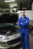 Happy mechanic by breakdown car — Stock Photo