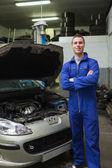 Happy mechanic by breakdown car — Stock Photo