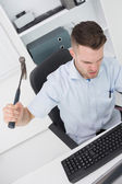 Frustrated man hitting computer monitor - keyboard with hammer — Stock Photo