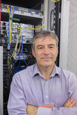 Technician standing in front of servers — Stock Photo