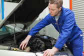 Mechanic closing the lid of windshield washer tank — Stok fotoğraf