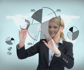 Businesswoman touching screen with graphs — Stock Photo
