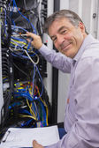 Smiling technician checking the server — Stock Photo