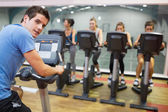 Male instructor at spinning class — Foto de Stock